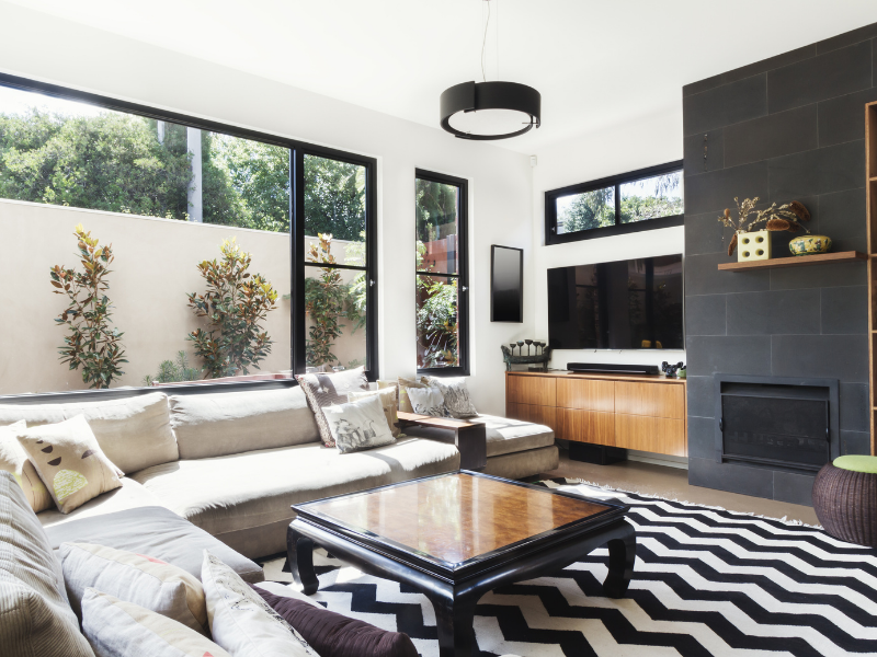 Living Room with black, brown, and taupe furniture.